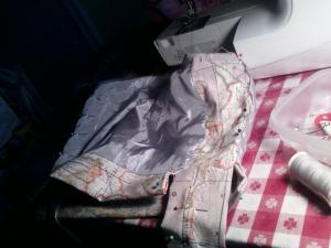 Adding decorative stitches to map bag